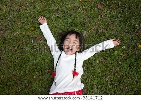 Portrait of the beautiful small Asian girl/ outdoors playing