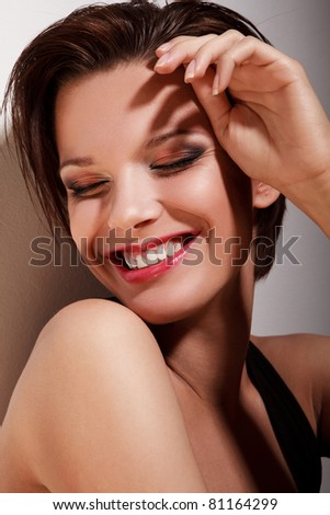 Portrait of the beautiful smiling woman