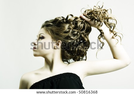 Portrait of the beautiful woman with long curly hair