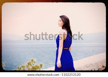 portrait of the beautiful young woman looking at the splendid view in Greece . Image made with old film frame. Zdjęcia stock ©