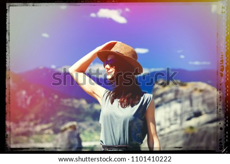 portrait of the beautiful young woman looking at the splendid view in Greece. Image with film old frame. Zdjęcia stock ©