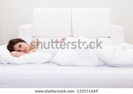 Portrait Of The Beautiful Young Woman Sleeping On Bed