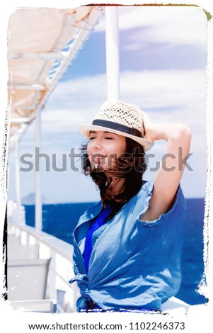 portrait of the beautiful young woman standing near the iron railing of the boat and relaxing in Greece . Image made with old film frame. Zdjęcia stock ©