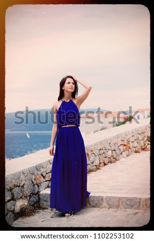 portrait of the beautiful young woman walking on the stone stairs of Greece . Image made with old film frame. Zdjęcia stock ©