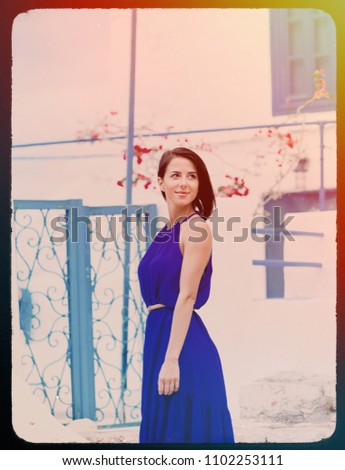 portrait of the beautiful young woman walking on the streets of Greece . Image made with old film frame. Zdjęcia stock ©