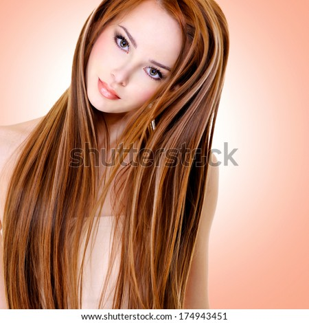 portrait of the beautiful young woman with long straight hairs
