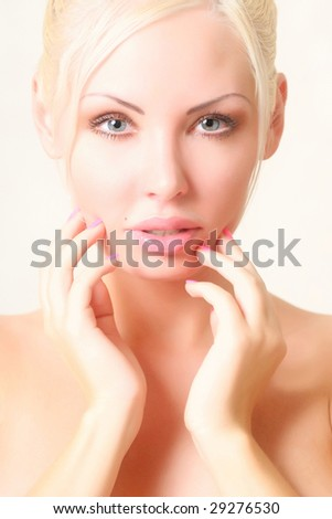 Portrait of the beautiful young woman with well-groomed hands at the person