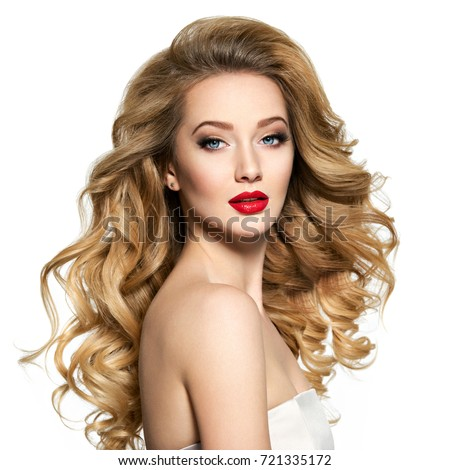 Stock Photo Portrait of the blonde woman with long  hair and red lips. Fashion model with bright makeup.