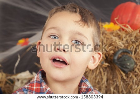 Portrait of the boy during Halloween photo shoot in the studio