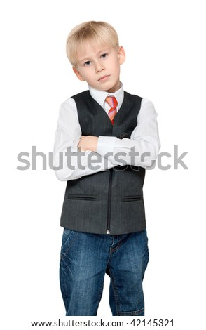 Portrait of the boy in vest and tie on white background