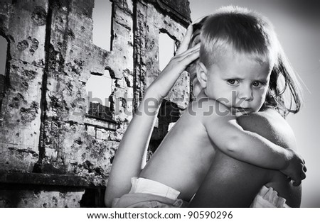Portrait of the boy on hands at mother escaping from accident