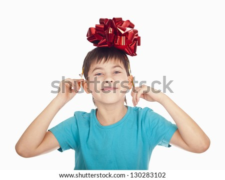 portrait of the boy who has control over a red bow on the head