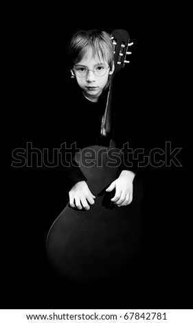 Portrait of the boy with a guitar