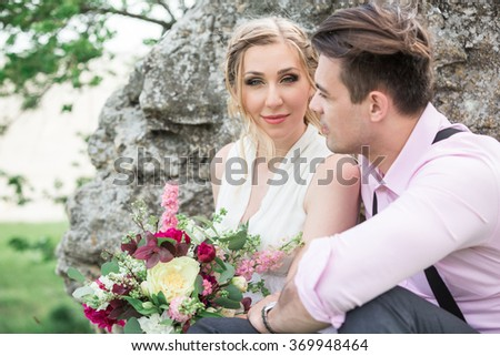 Portrait of the bride and groom outdoors #369948464