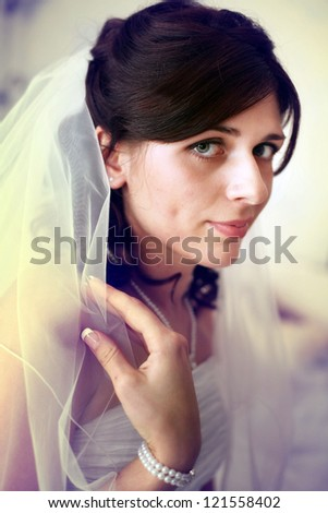 portrait of the bride at a wedding, in a white dress with flowers