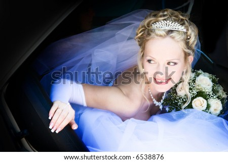 Portrait of the bride sitting in the car
