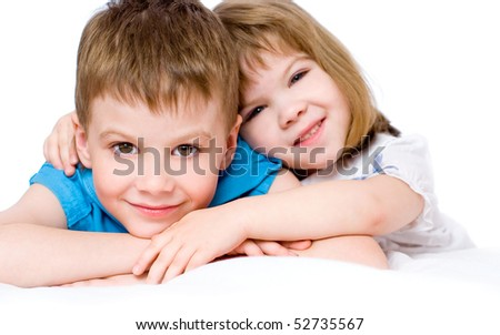 Portrait of the brother and its little sister, on a white background