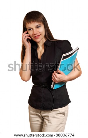 Portrait of the business woman with a mobile phone