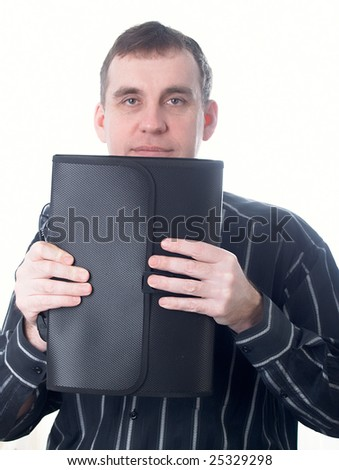 Portrait of the businessman in a dark shirt with a portfolio at office