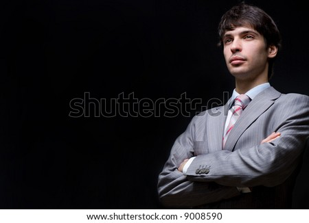 Portrait of the businessman in a grey suit