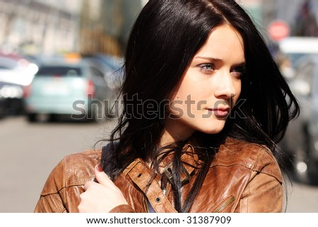 Portrait Of The City Girl In Brown A Leather To A Jacket Stock Photo ...