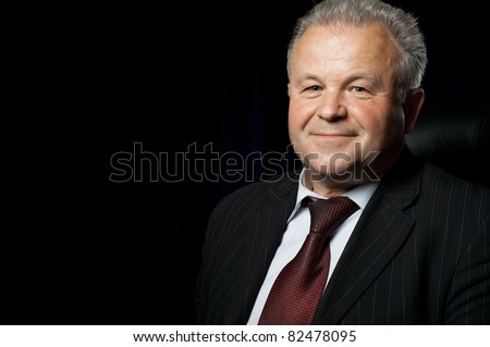 Portrait of the elderly man. A photo against a dark background
