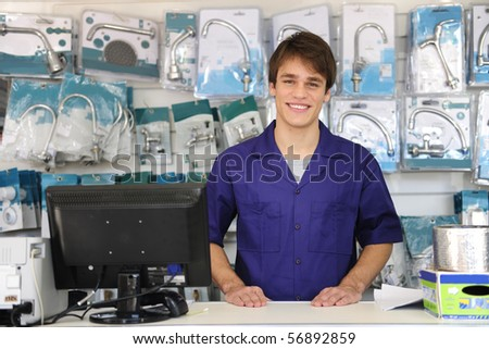 portrait of the friendly owner of a building supplies store - stock photo