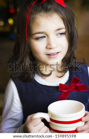 Portrait of the girl child drink from a cup