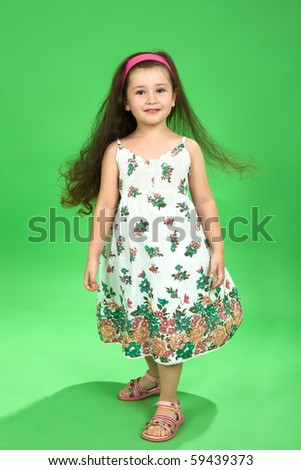 Portrait of the girl on a green background