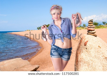 Portrait of the girl walking on coast barefootv
