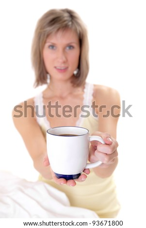 Portrait of the girl with a cup of coffee