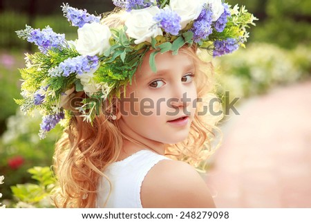Portrait of the girl with a wreath on his head in the spring.