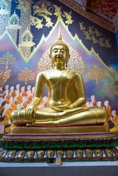 portrait of the golden Buddha statue inside the temple of Wat Phra bat Huay Tom