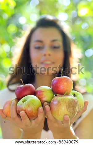 portrait of the gorgeous woman with bright fresh red apples