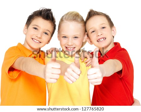 Portrait of the happy children with thumbs up gesture  isolated on white.