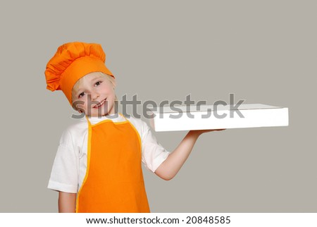 Portrait of the little cook with a box for pizza