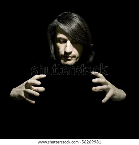 Portrait of the man of the illusionist on a black background