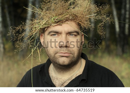 Portrait of the man with a wreath on a head