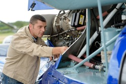 portrait of the mechanics of the helicopter