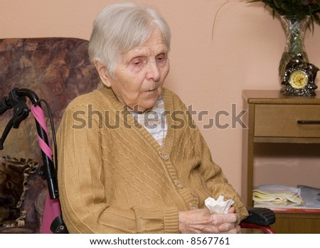 Portrait of the old woman at a nursing home. - stock photo
