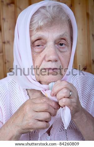 Portrait of the old woman in a kerchief close up