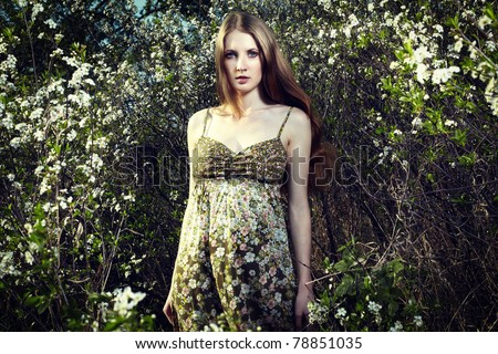 Portrait of the romantic woman in a summer garden
