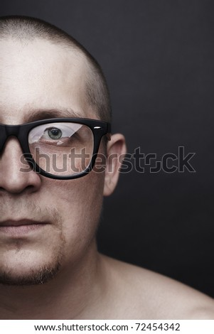 Portrait of the serious young man wearing spectacles