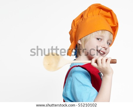 Portrait of the small cook on a light background