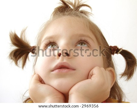 portrait of the small pretty dreaming girl - stock photo