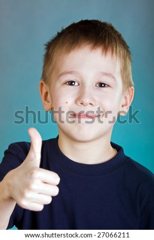 Portrait of the smiling boy isolated on a white background