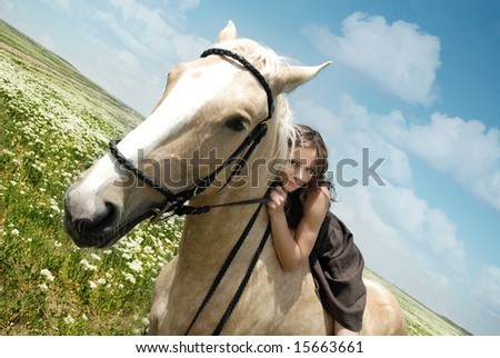 Portrait of the smiling woman and horse outdoors