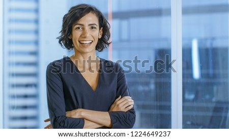 Portrait of the Successful Businesswoman Crossing Her Arms and Smiles. Beautiful Woman Executive Standing in Her Office. #1224649237
