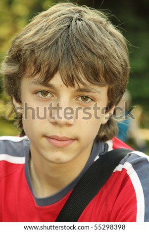 Portrait of the teenager on street - stock photo