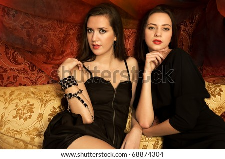 Portrait of the two beautiful women in oriental interior